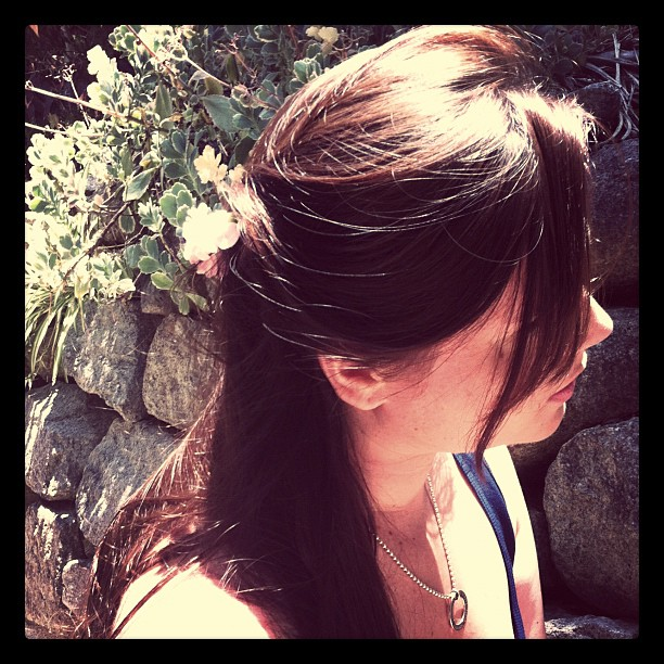 Wear a flower in your hair: on the side / half up
