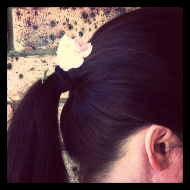 Wear a flower in your hair: in a pony tail