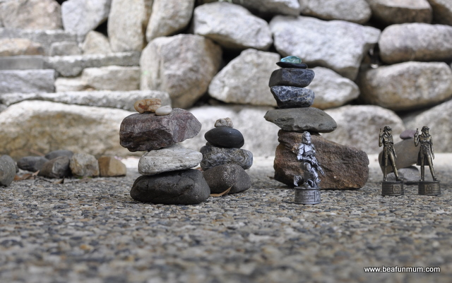 Imaginative play scene -- rock towers