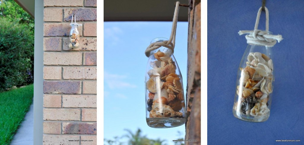 shells in a juice bottle hanging wall vase