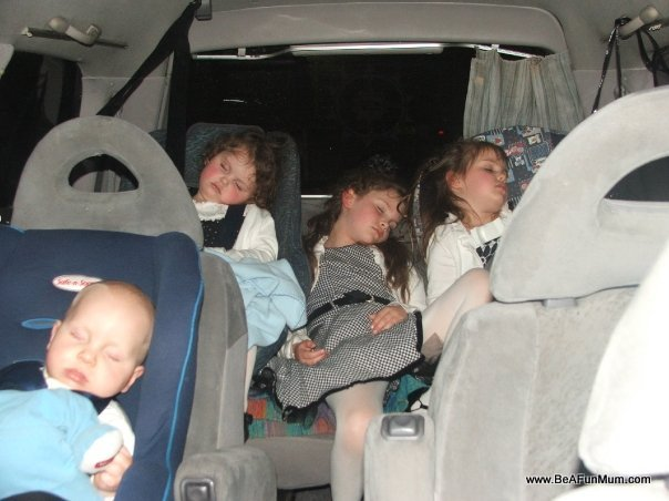 kids asleep in car