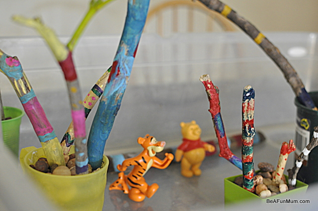painted sticks -- rainbow woods imaginative play scene