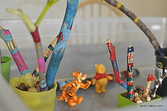 painted sticks -- rainbow woods imaginative play scene