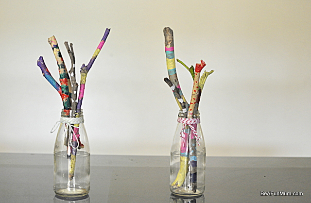 painted sticks -- in juice bottles