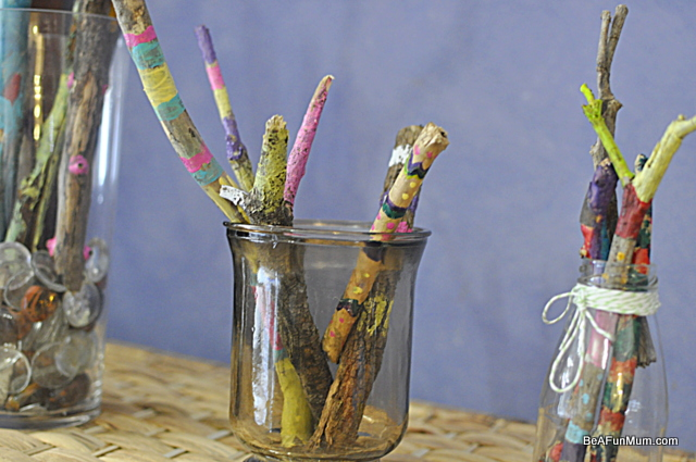 painted sticks -- in vases