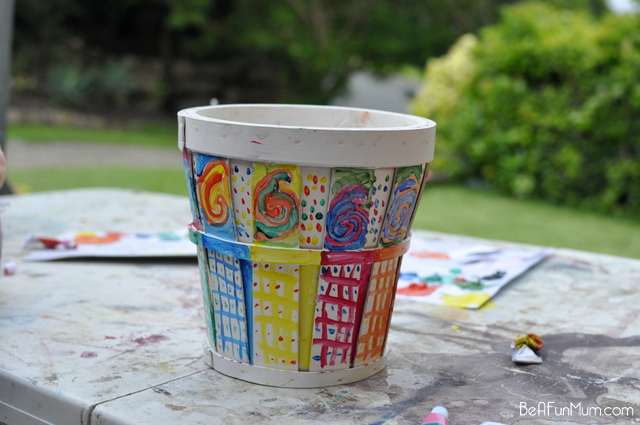 painting rainbow pots for the garden