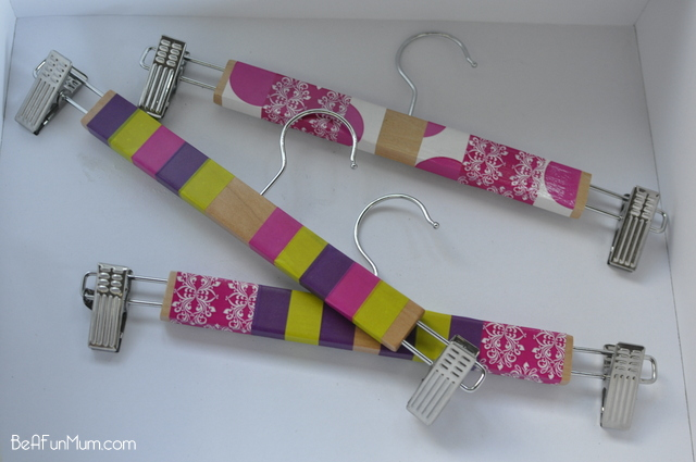 Pant hangers with clips can be used to hang children's artwork on the wall.  It's easy to change the artwork as fresh pieces come along.  To make it bright and fun, decorate the hangers with happy coloured tape.
