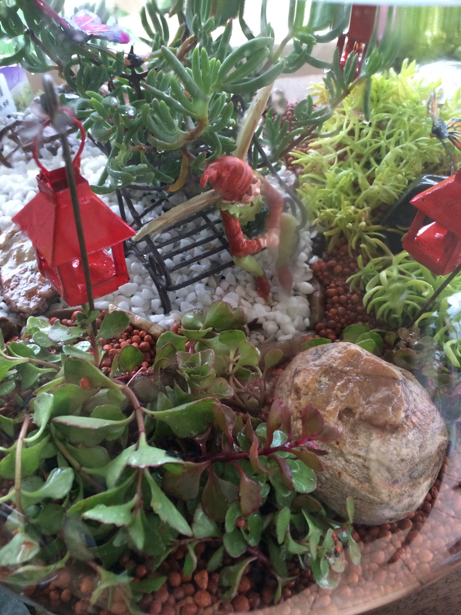 Miniature Terrarium Fairy Garden fairy having a break from gardening