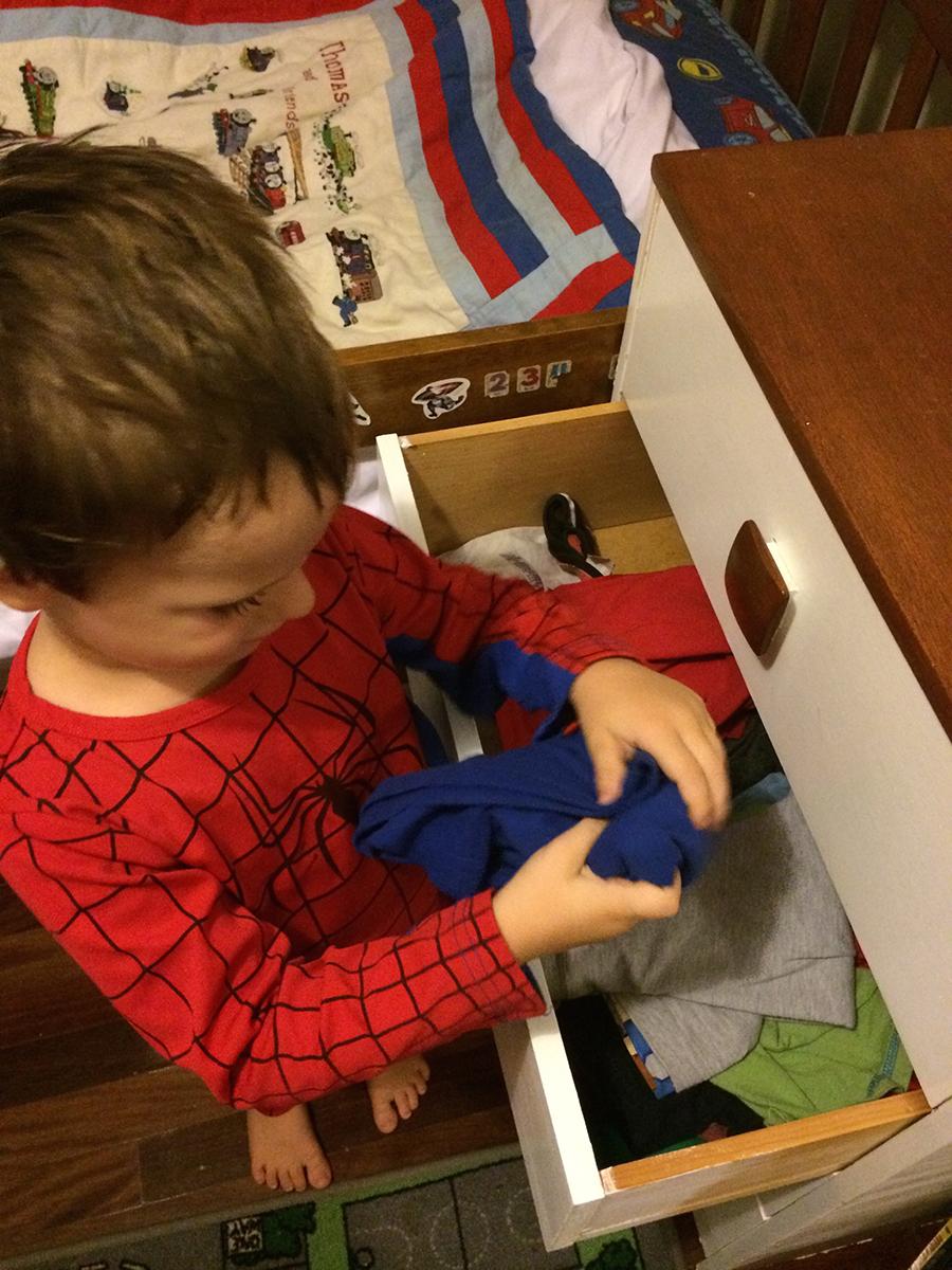 The Bucket Chore System putting stuff away boy