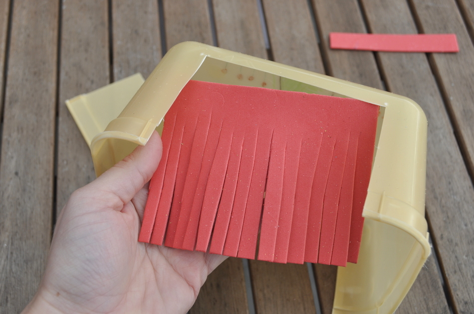 http://beafunmum.com/2015/06/cardboard-craft-mini-books-library-box/
