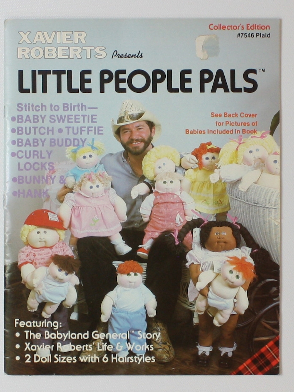 "Xavier Roberts with the original ""Little People"" which later became Cabbage Patch Kids"