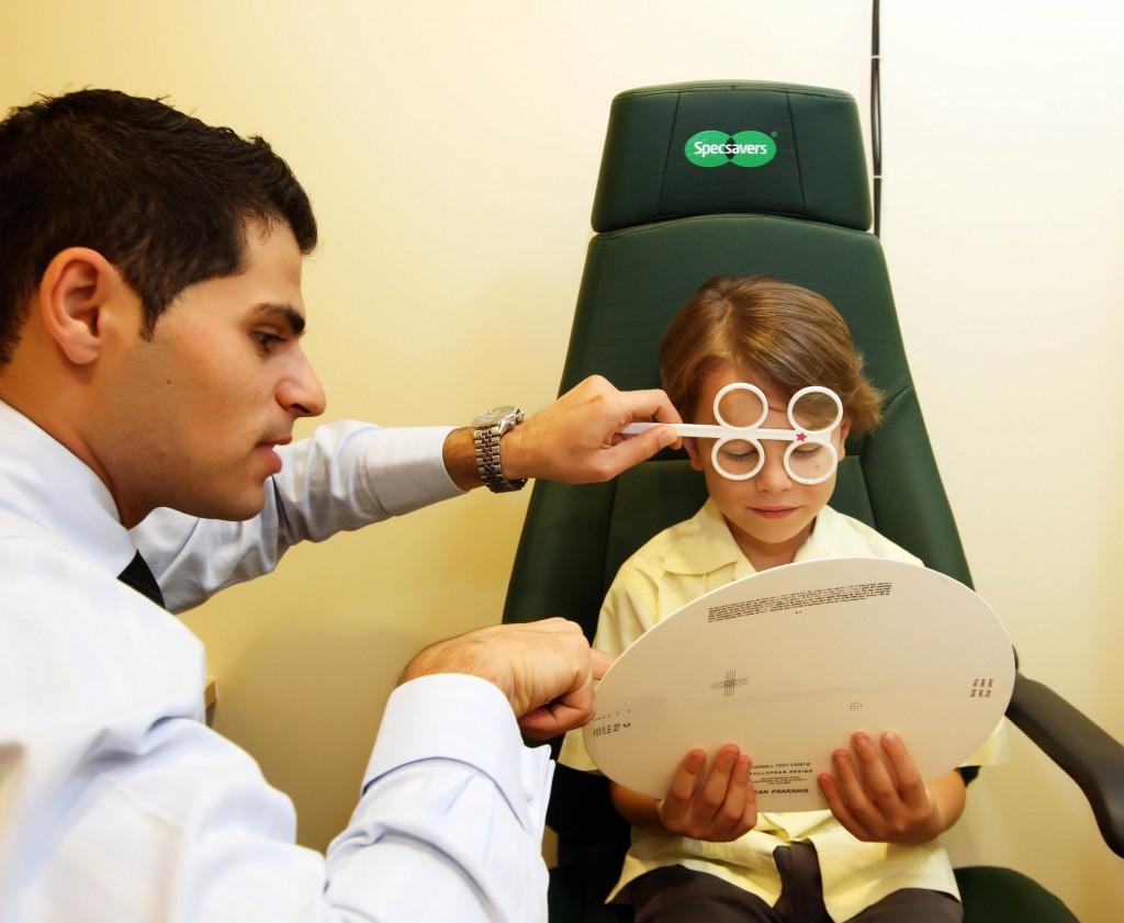 School boy taking eye test