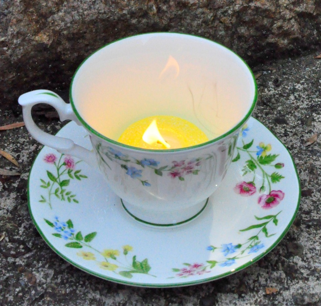 reuse items around the house -- tea cup as a candle