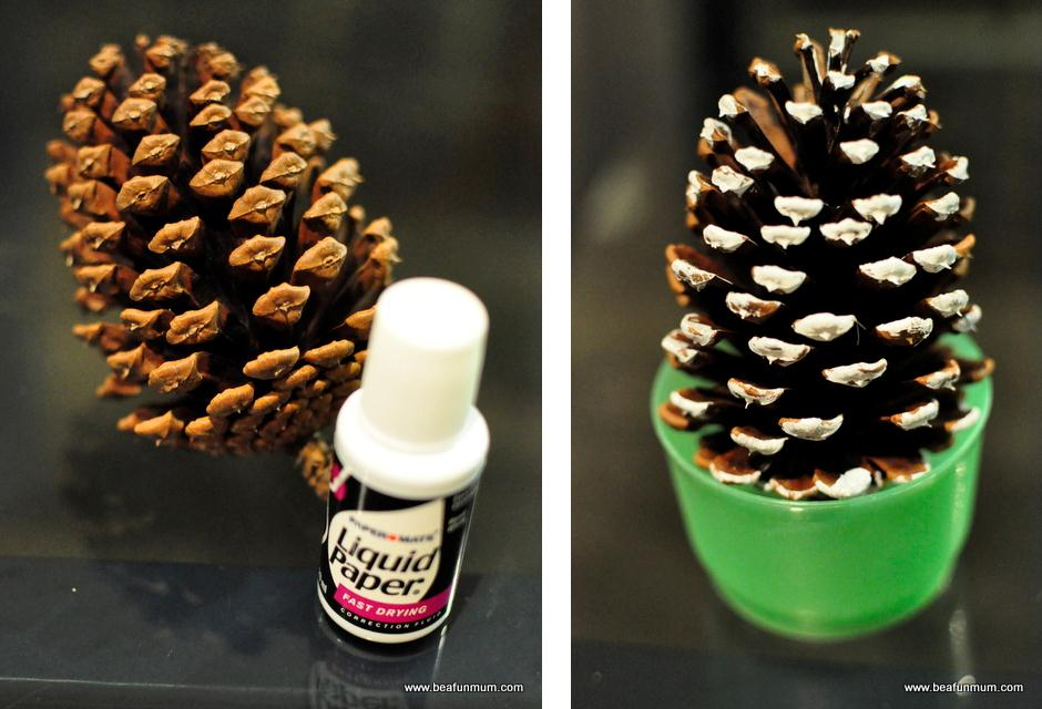 painted pine cone snow with liquid paper