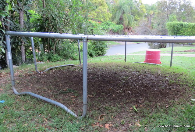what to do with dead grass under play equipment/trampoline