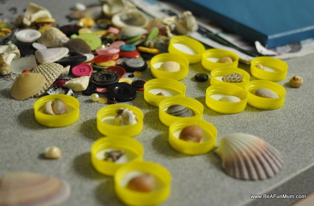 display shells shadow box -- milk bottle lids