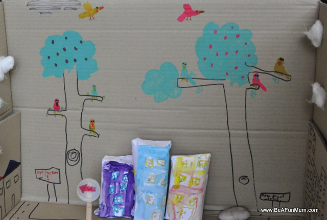 cardboard box play scene -- trees and buildings