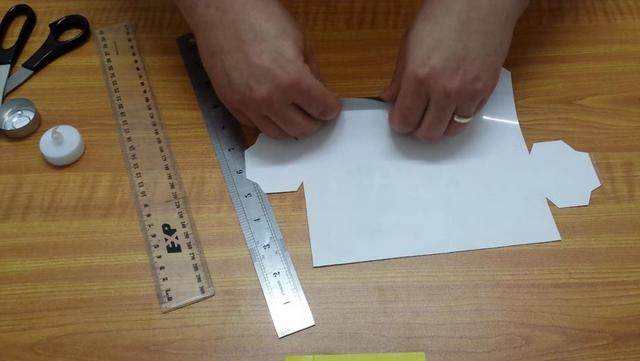 Use one ruler to guide you down the tab line and the other ruler to make a score line.
