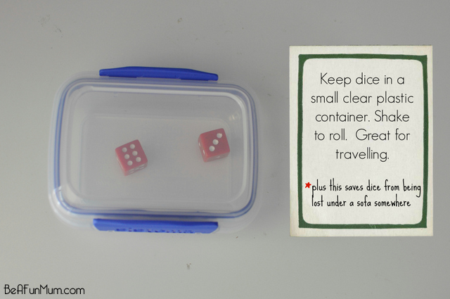 Keep dice in a small clear plastic container. Shake to roll. Great for travelling.