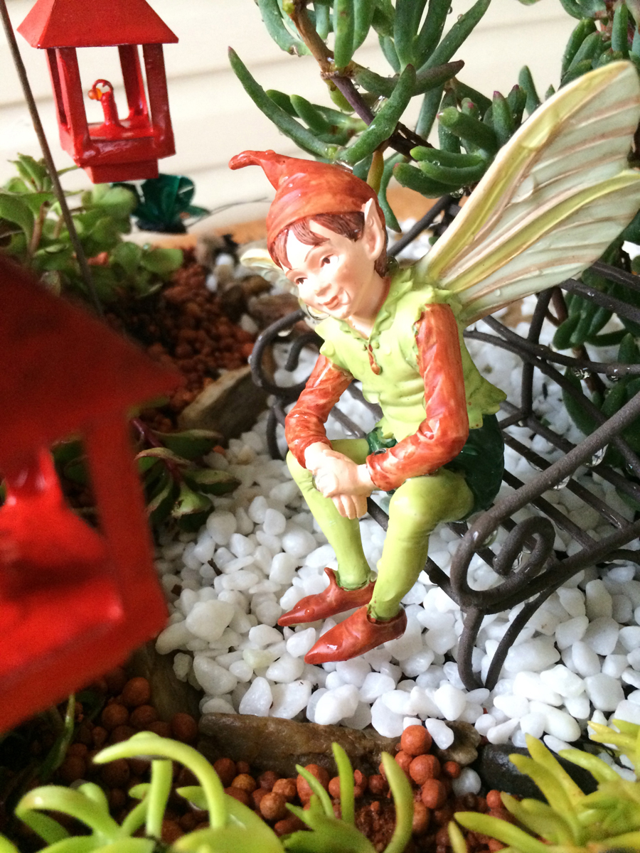 Miniature Terrarium Fairy Garden fairy boy sitting on sit